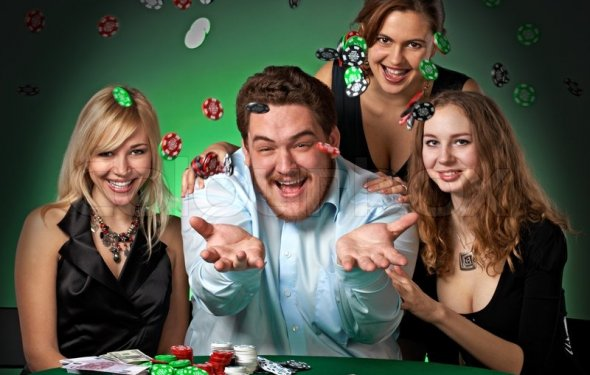 Poker players in casino with