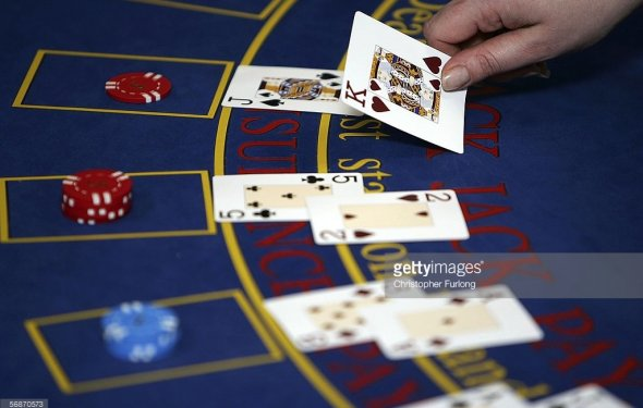 A croupier deals cards on a