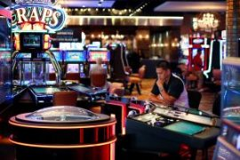 In this Sept. 24, 2015, photo, a man plays an electronic roulette game at the Downtown Grand hotel and casino in Las Vegas. As gamblers move away from traditional slot machines, game-makers and casinos are looking at new ways to keep people playing.