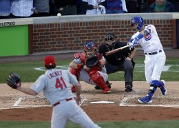 Javier Baez hits a three-run home run during the second inning of Game 4 of the NLDS at Wrigley Field. AP