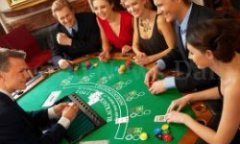 People Playing Blackjack in Casino