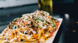 The nachos at Guy Fieri's Kitchen & Bar are big enough to share with a friend. Photo courtesy of Caesars Entertainment