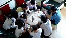 Young Vietnamese playing card game - with money